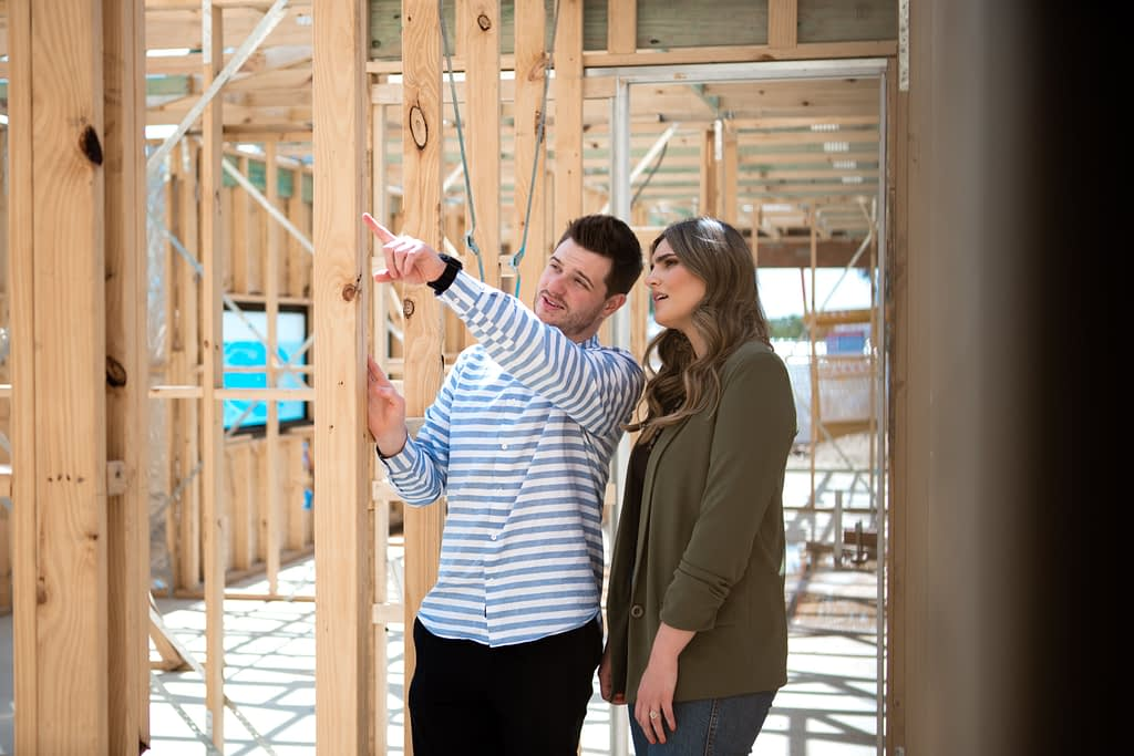 Couple reviewing their new home under construction